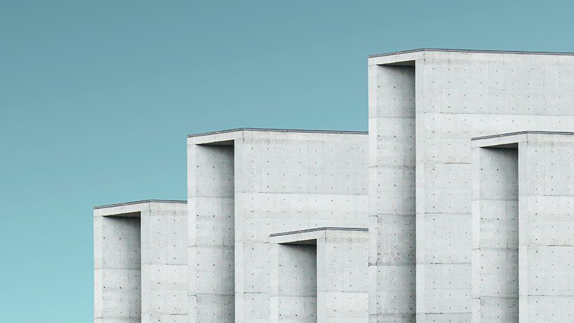 Concrete blocks of varying heights against a blue background