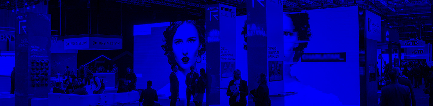 Blue treatment to image of event stand at Sibos with large LED screen displaying images of twins and a number of people standing around in the Refinitiv stand
