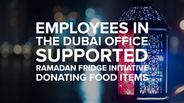 A lamp representing Ramadan season with the text saying 'employees in the dubai office supported ramadan fridge initiative donating food items'