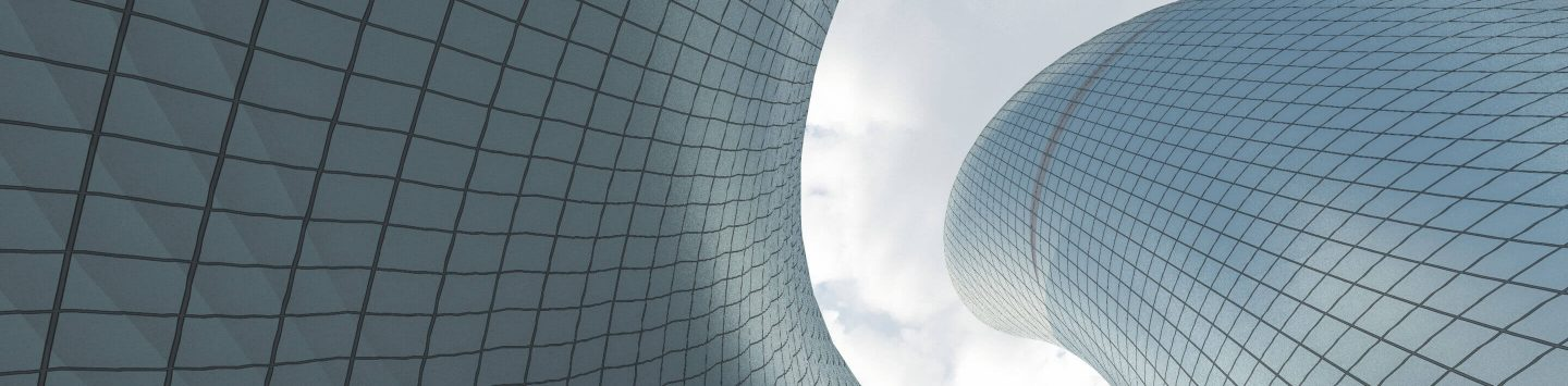 Swirling modern blue architecture against a cloudy day