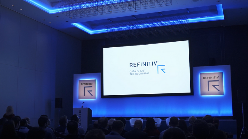 Giant screen featuring the Refinitiv logo at the Energy Interactive event